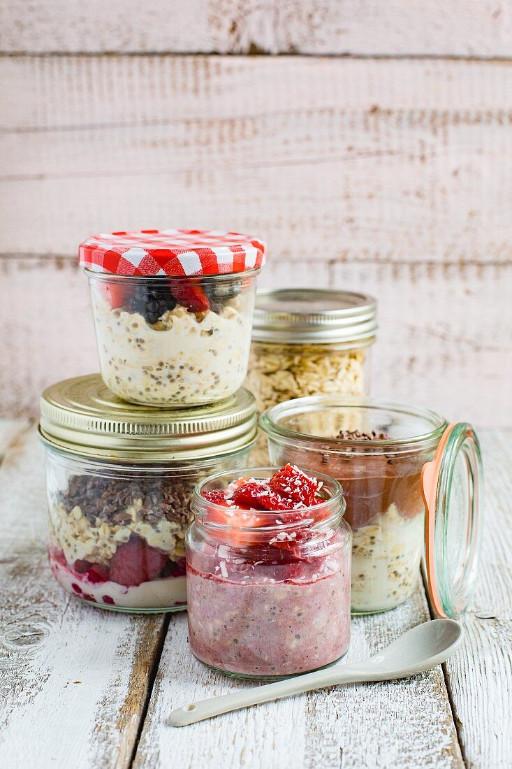 Different varieties of overnight oats in glass jars