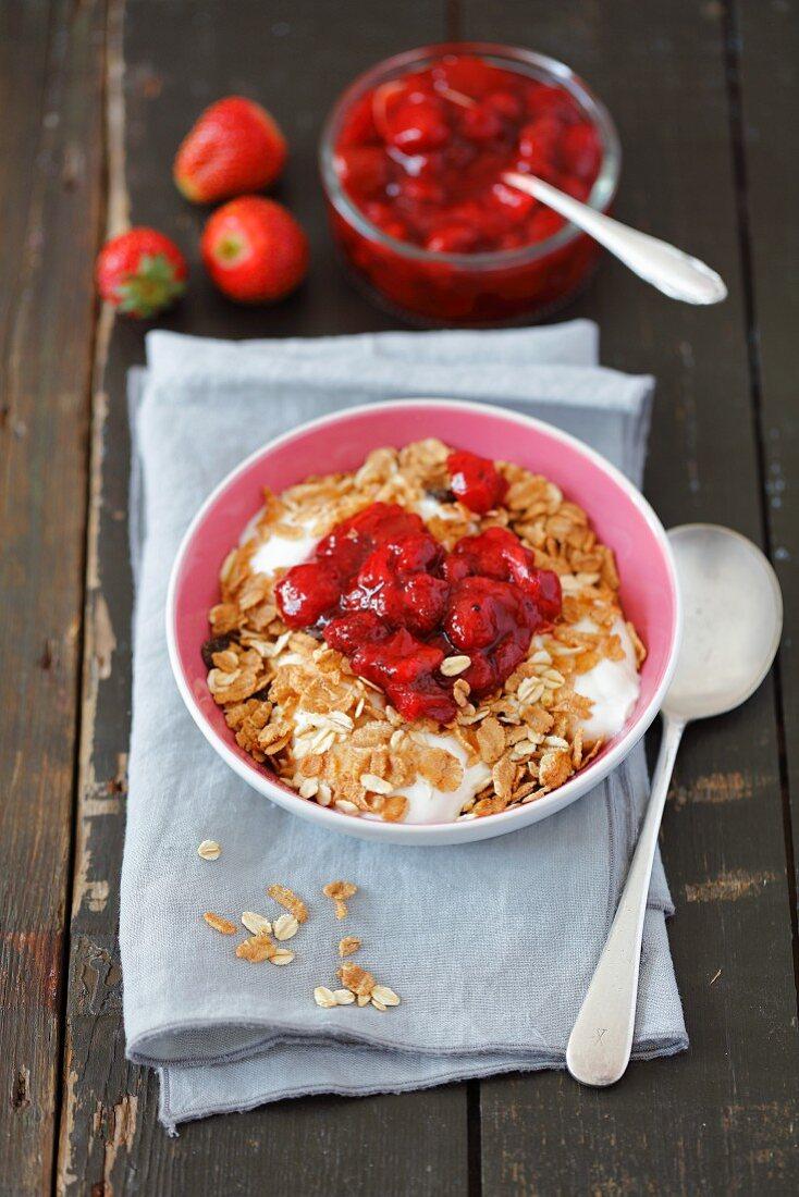 Yoghurt with muesli and strawberry jam