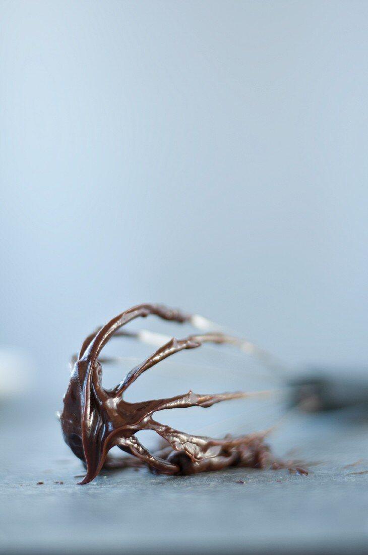 Dark chocolate ganache on a whisk