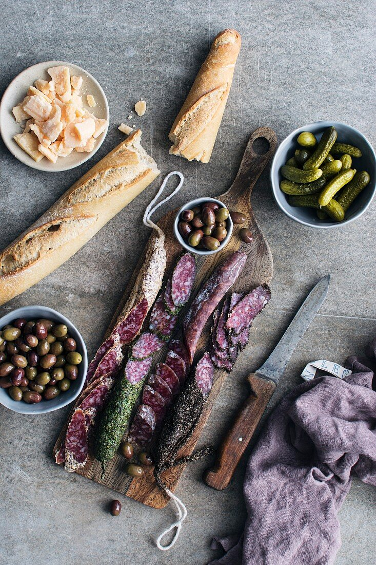 Spanish tapas: various sausages served with bread, olives and cornichons (Spain)