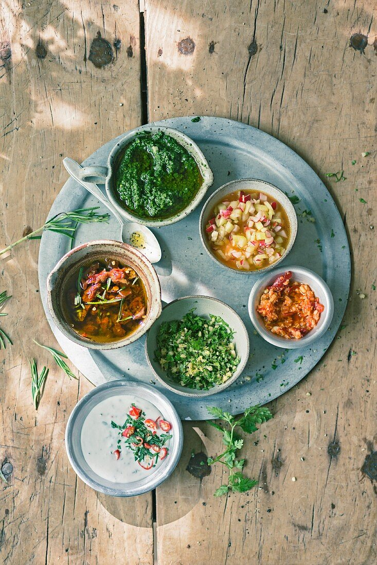 Coconut and chilli sauce, tomato and rosemary oil, herb and pistachio pesto, chervil and pine nut gremolata, radish and cucumber salsa and ginger and chilli paste