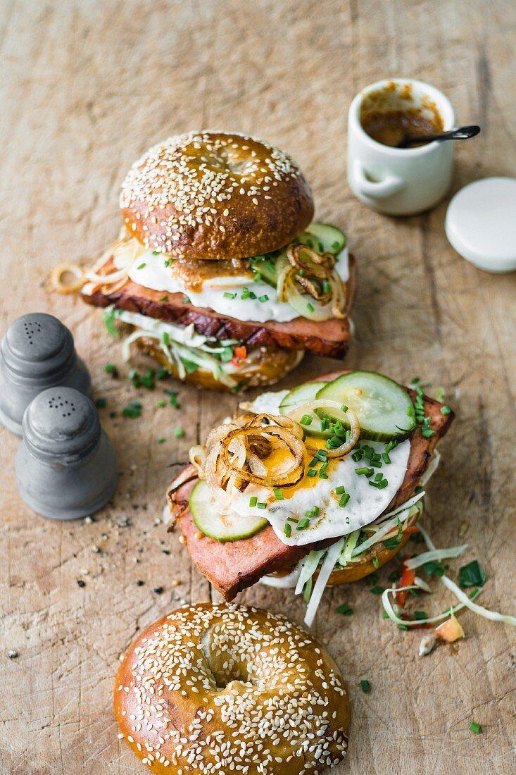 Bagels with Leberkäse, coleslaw, sweet mustard, and fried eggs
