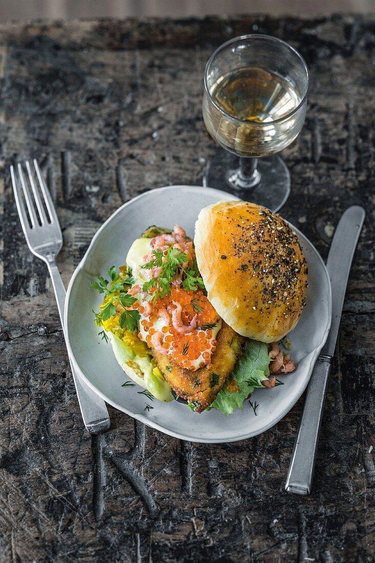 A fish burger with wasabi mayo, cucumber and apple relish, North Sea shrimp, and caviar