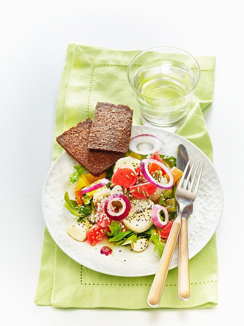 A salad of lacto fermented vegetables, seeds, and wholegrain bread