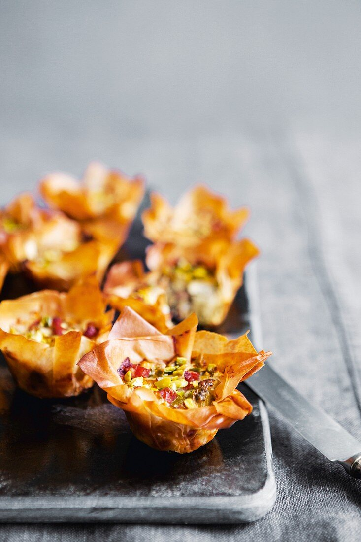 Feta and bacon tartlets with pistachios