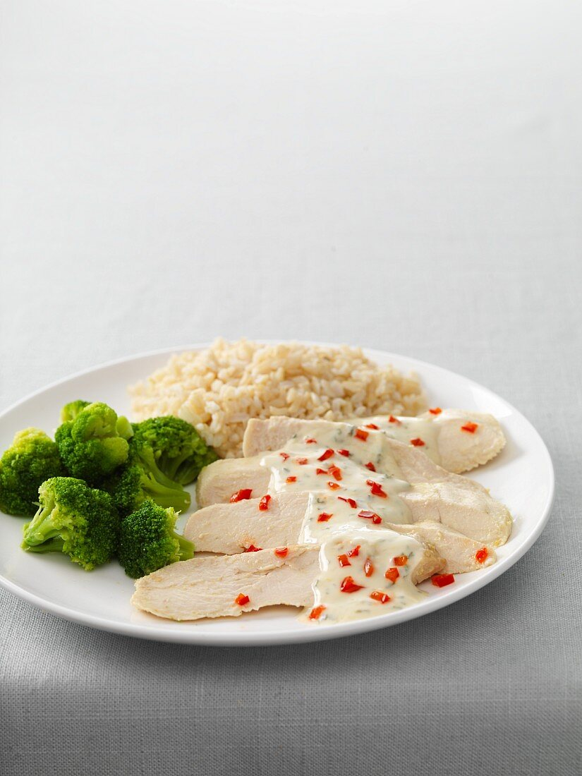 Chicken breast fillets with Dijon mustard, broccoli, and rice