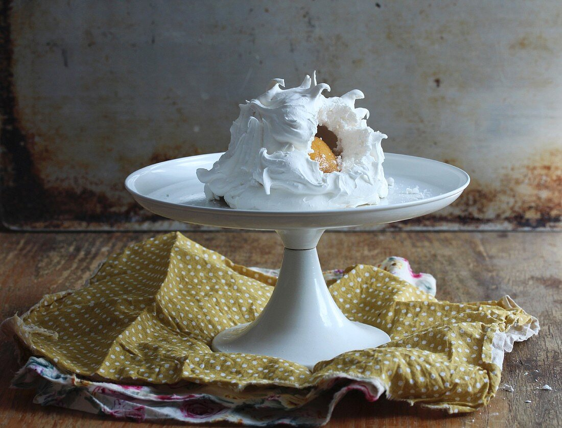 Pavlova with fruit on a cake stand