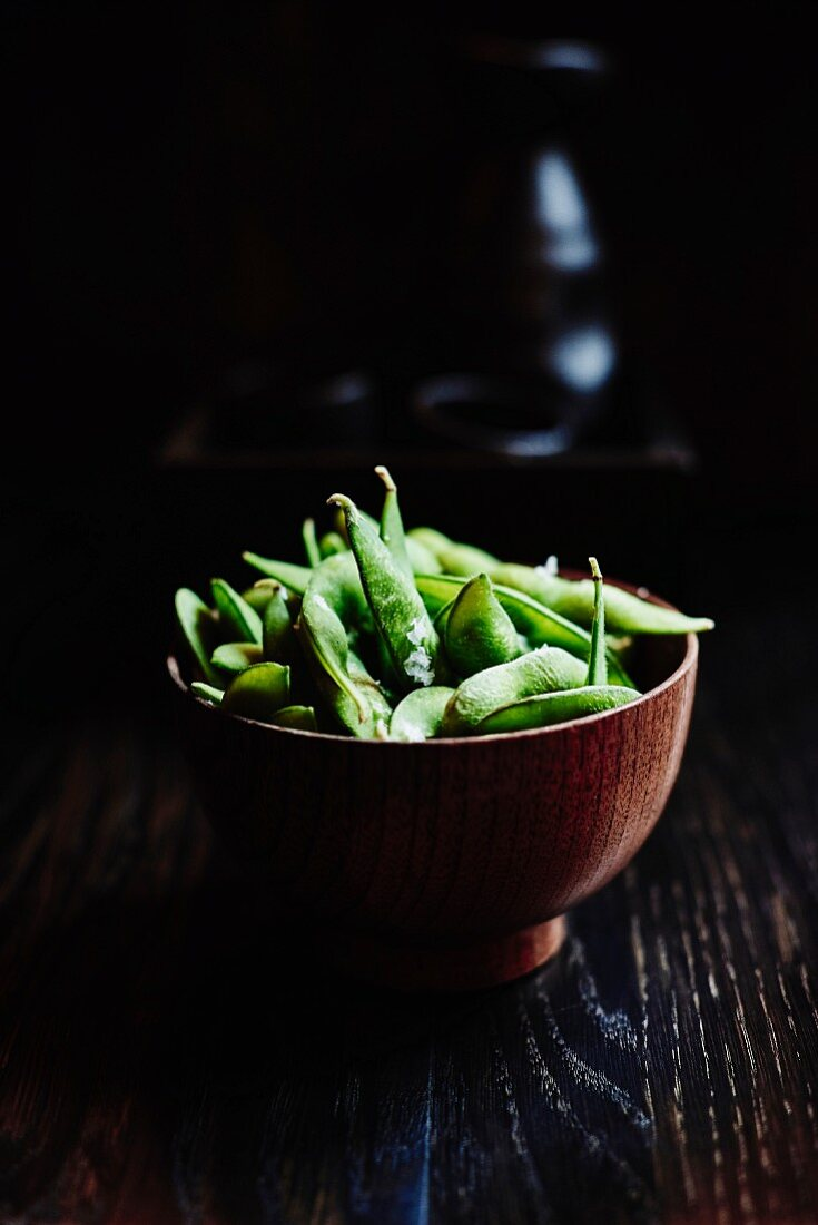 Steamed edamame beans with salt flakes japanese restaurant style