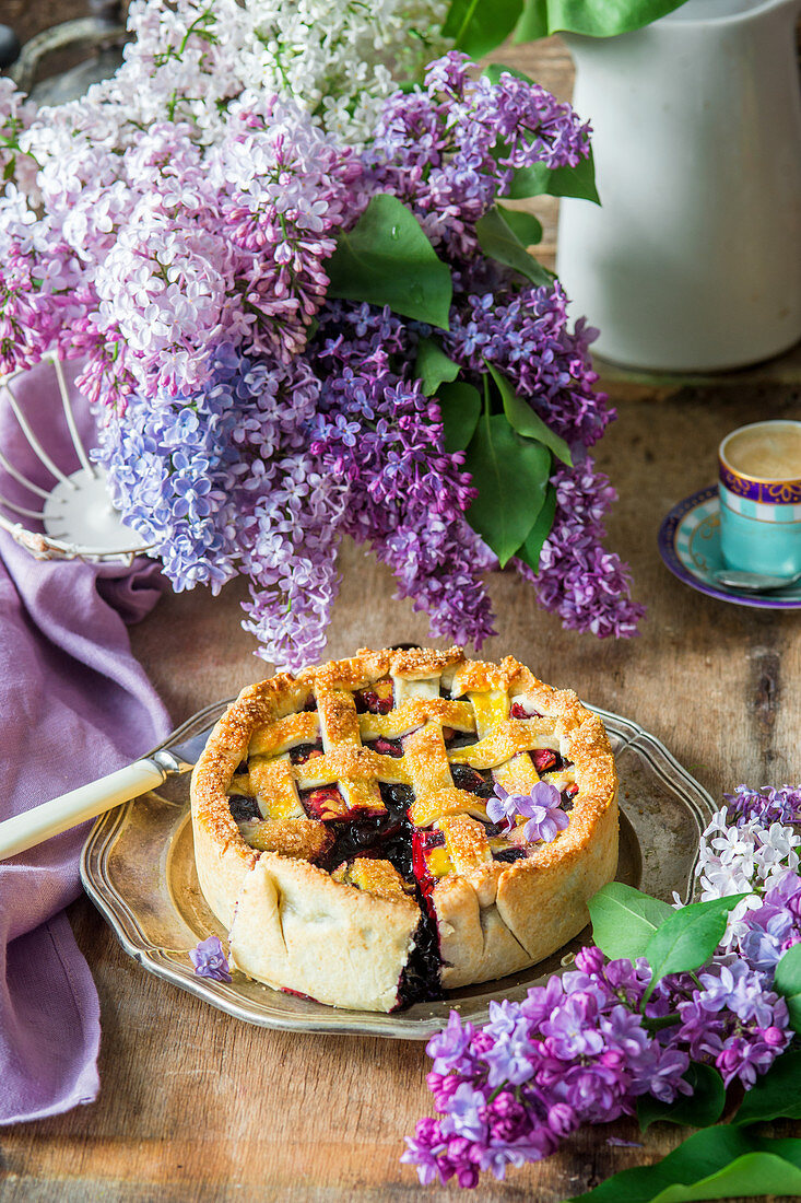 Blueberry pie surrounded by lilac