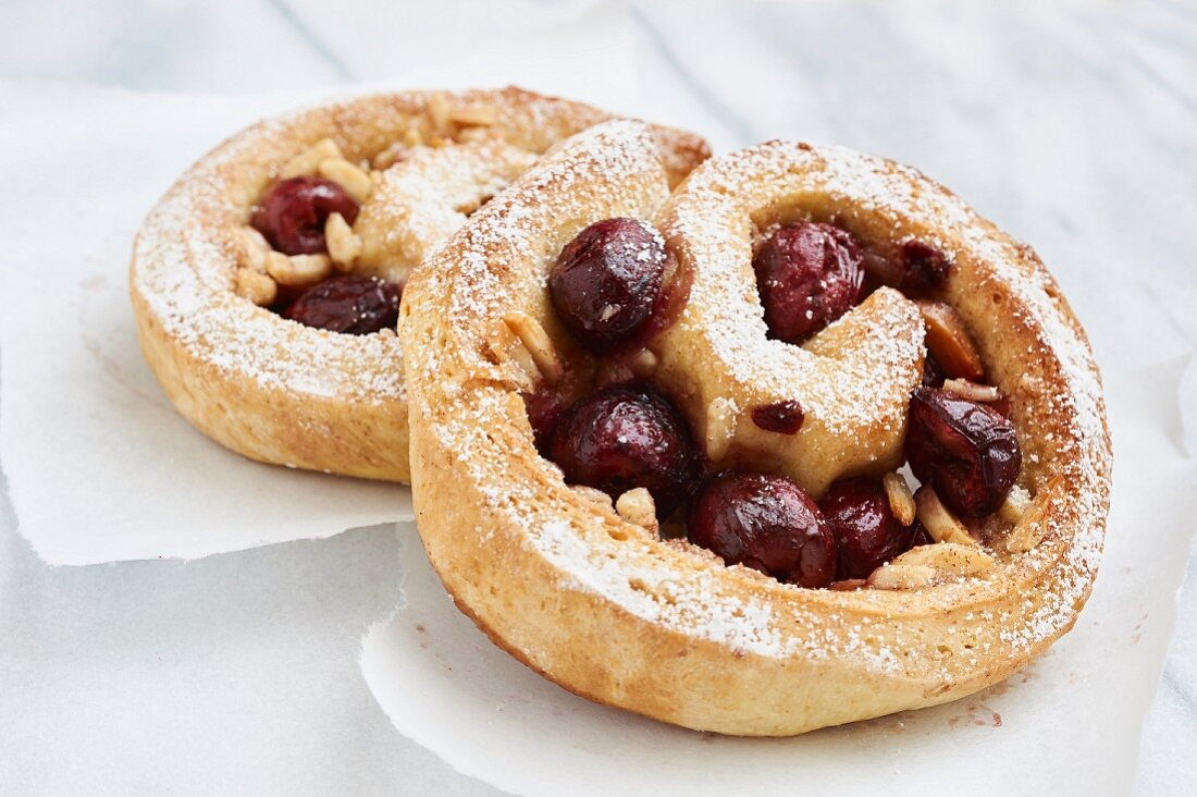 Yeast pastry snails with cherries and almonds