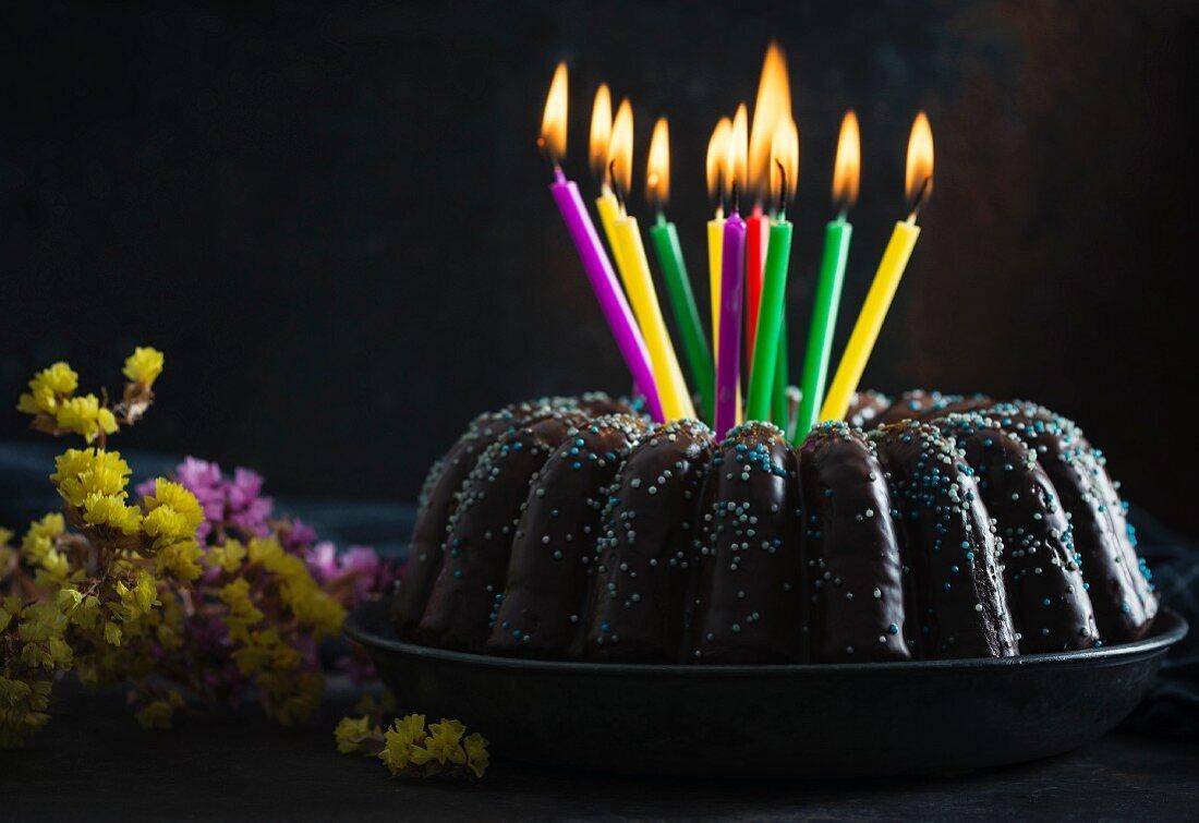 A vegan gugelhupf with birthday candles
