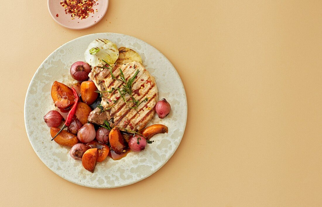 Balsamic apricots with a grilled pork chop