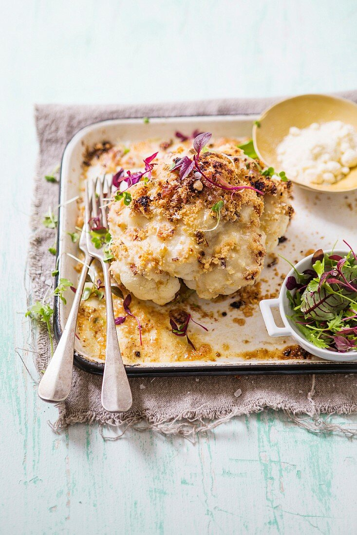 Baked cauliflower with bacon and a parmesan crust
