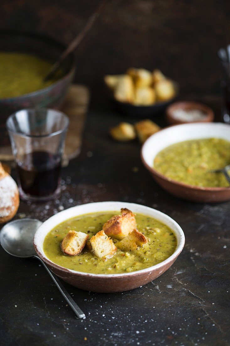 Pea soup with pork knuckle and croutons