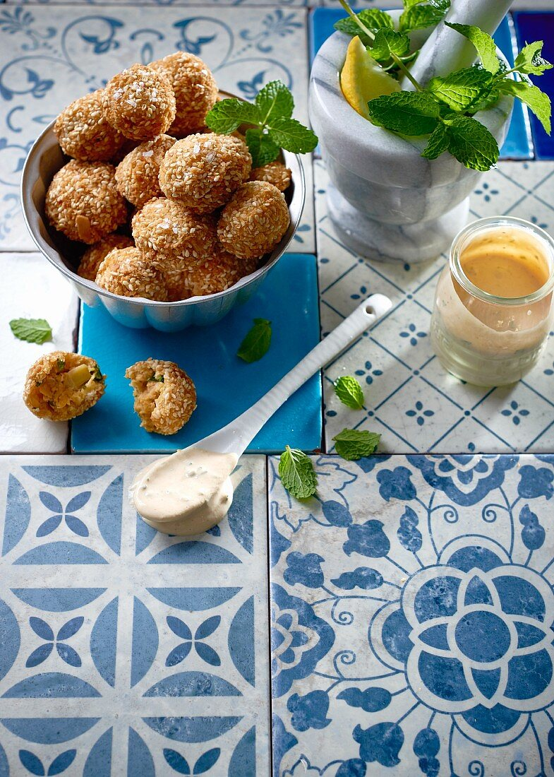 Deep fried sesame balls with a yogurt and tahini dip