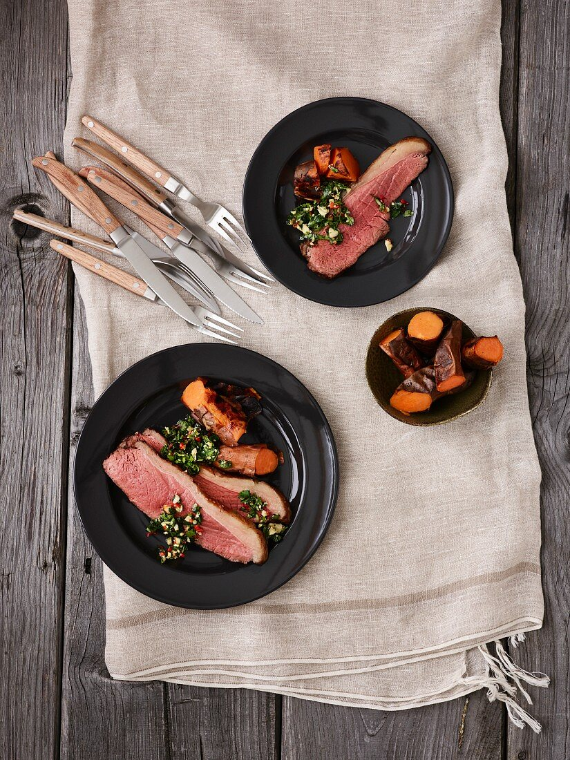 Picanha (grilled beef) with chimichurri sauce and sweet potatoes