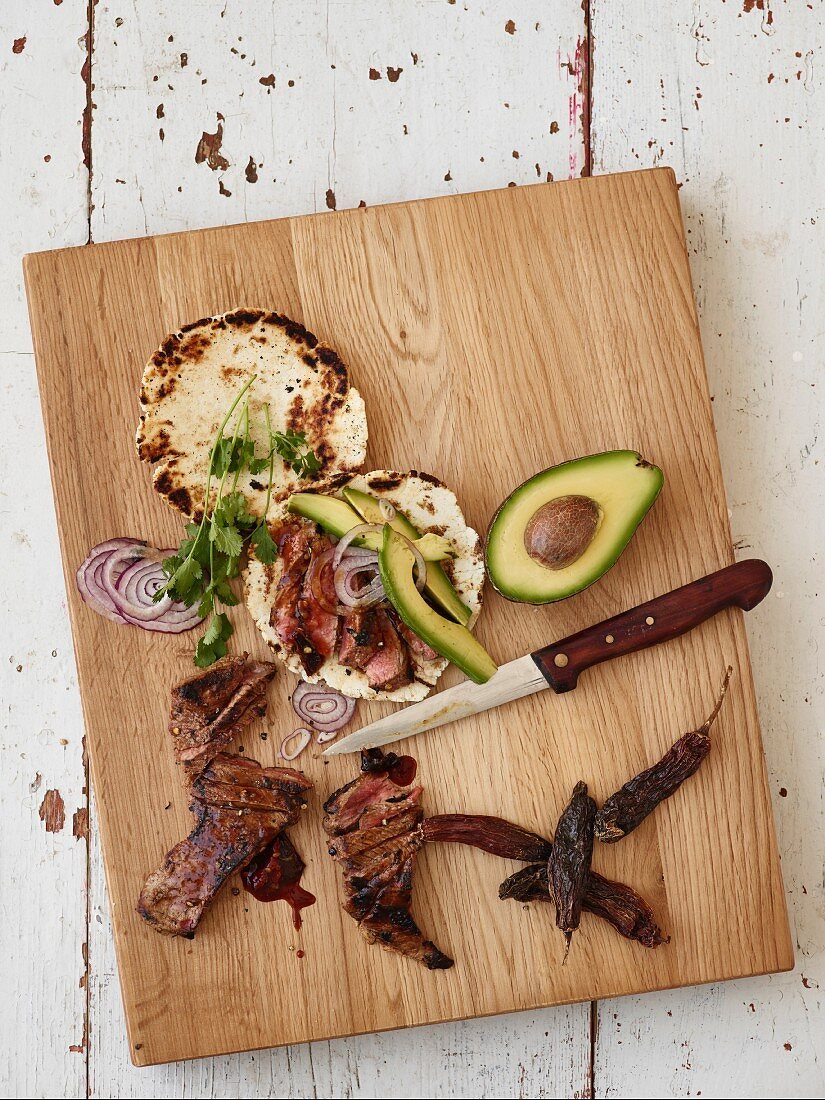 Skirt steak tortillas with avocado, onion and coriander