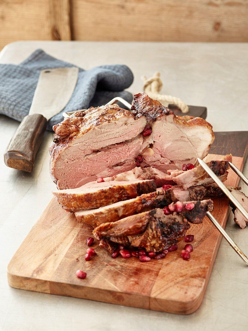 Stuffed grilled lamb with pomegranate seeds