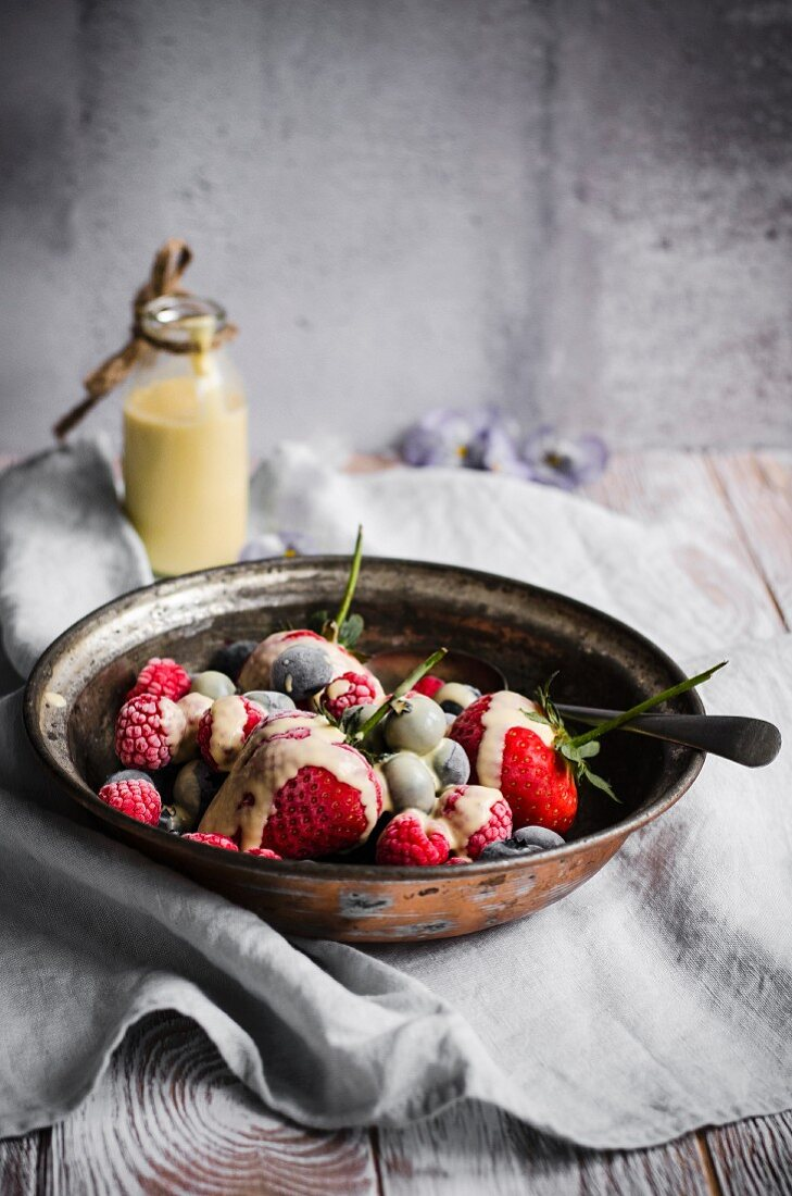 Frozen berries witha creme anglaise sauce, dairy free