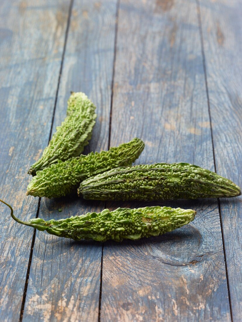 Bitter cucumbers on a wooden background
