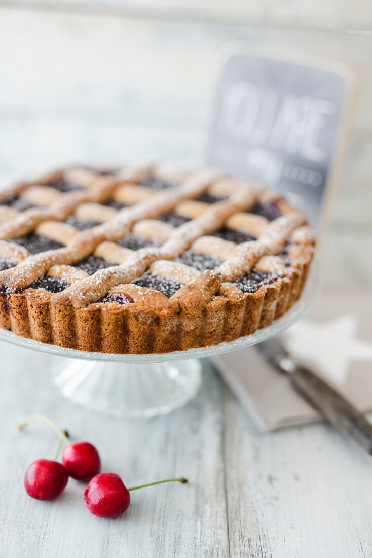 Linzer cake dusted with icing sugar