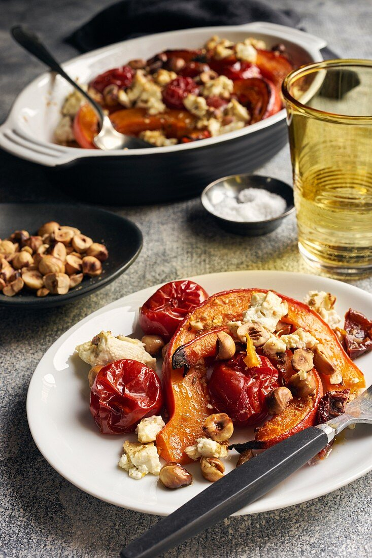 Roasted pumpkin with cherry tomatoes, sheep's cheese and hazelnuts
