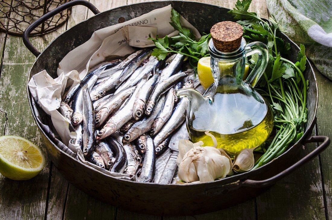 Fresh anchovies, olive oil, garlic, lemon and parsley