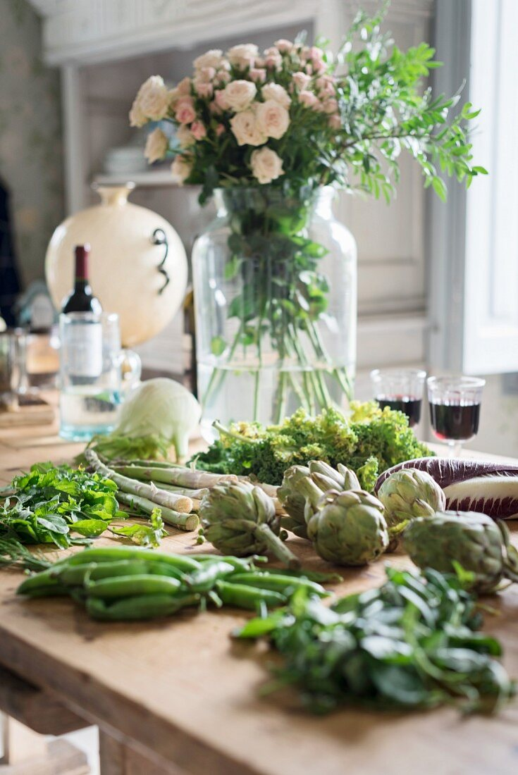 Vegetables on a kitchen table being prepared for cooking