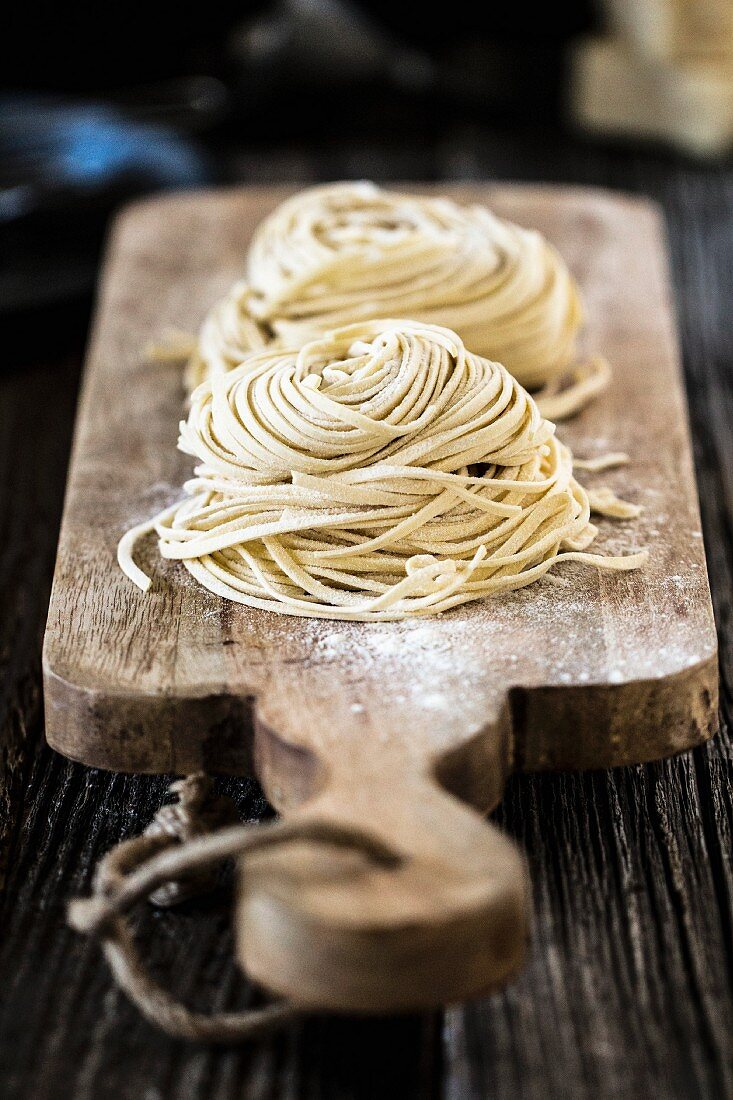 Fresh homemade noodles on a chopping board