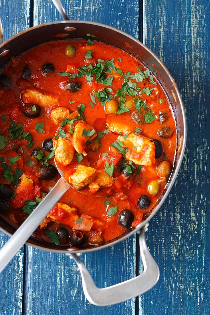 Turkey breast gulash with tomatoes, olives and capers