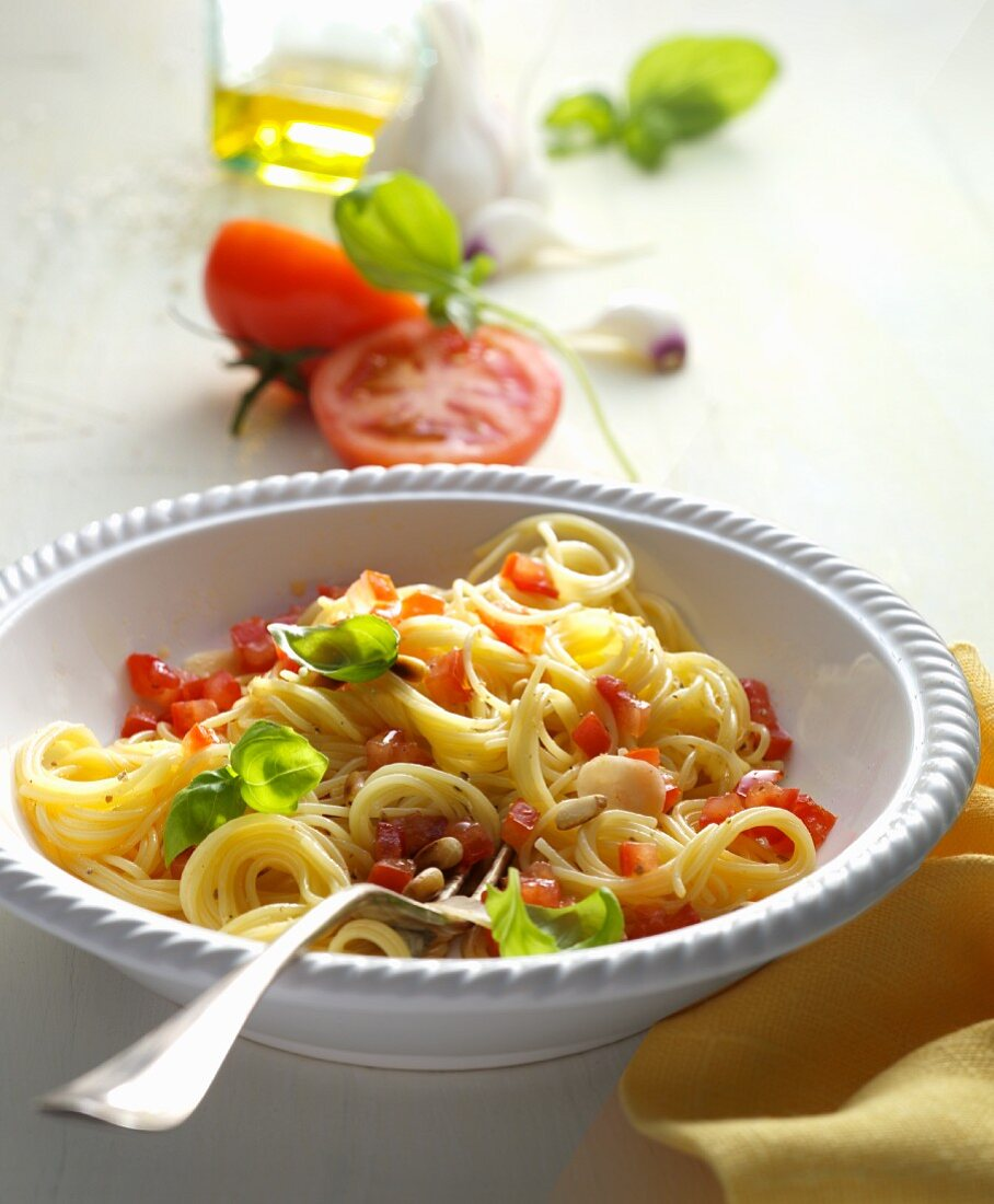 Pasta with tomato chunks and pine nuts