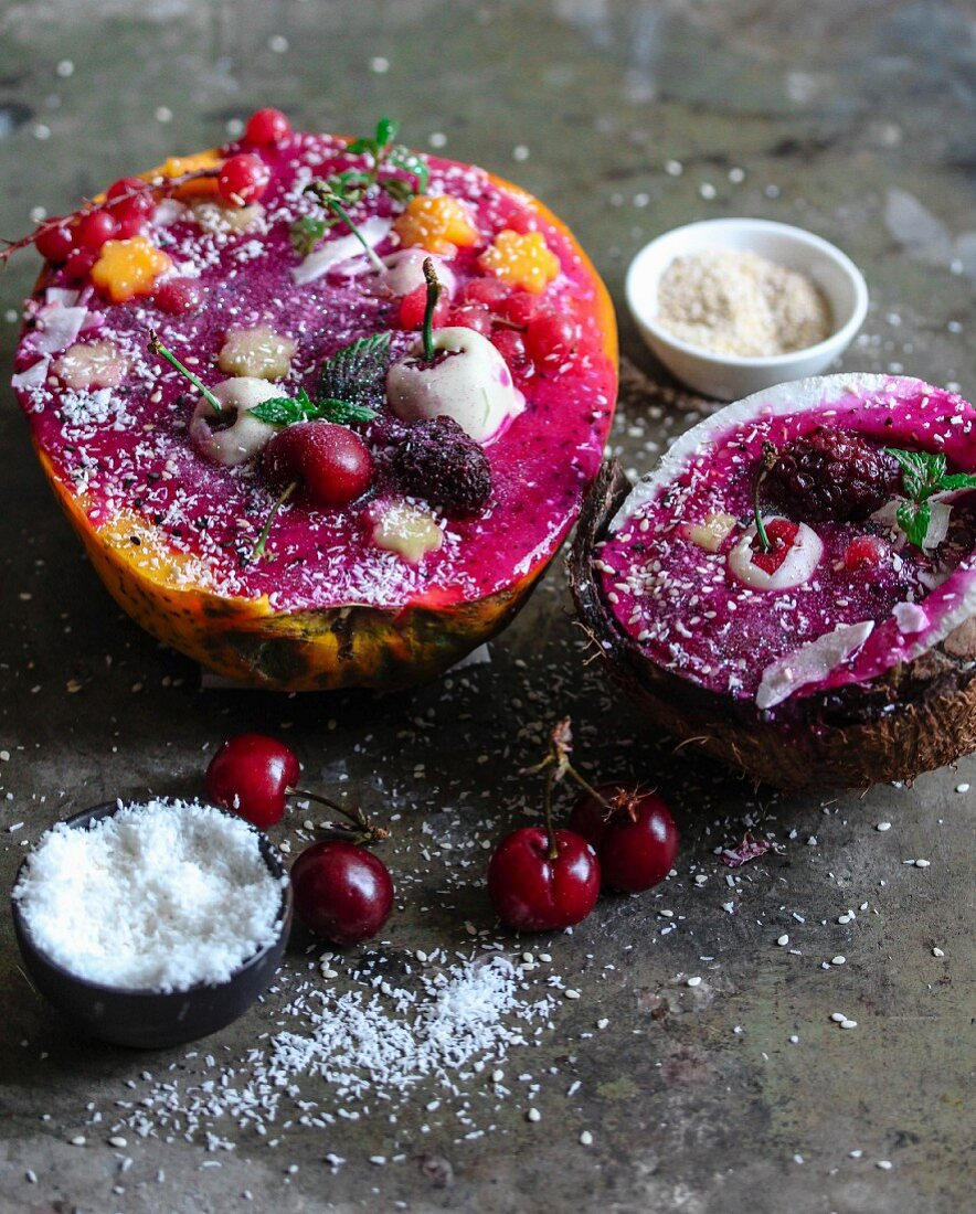 Smoothie bowls in melon and coconut halves