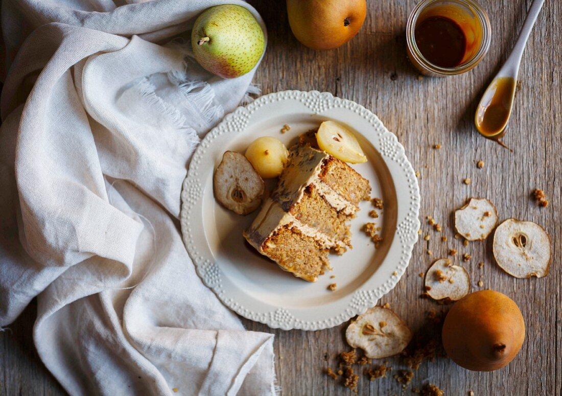 A piece of autumnal pear cake with caramel sauce