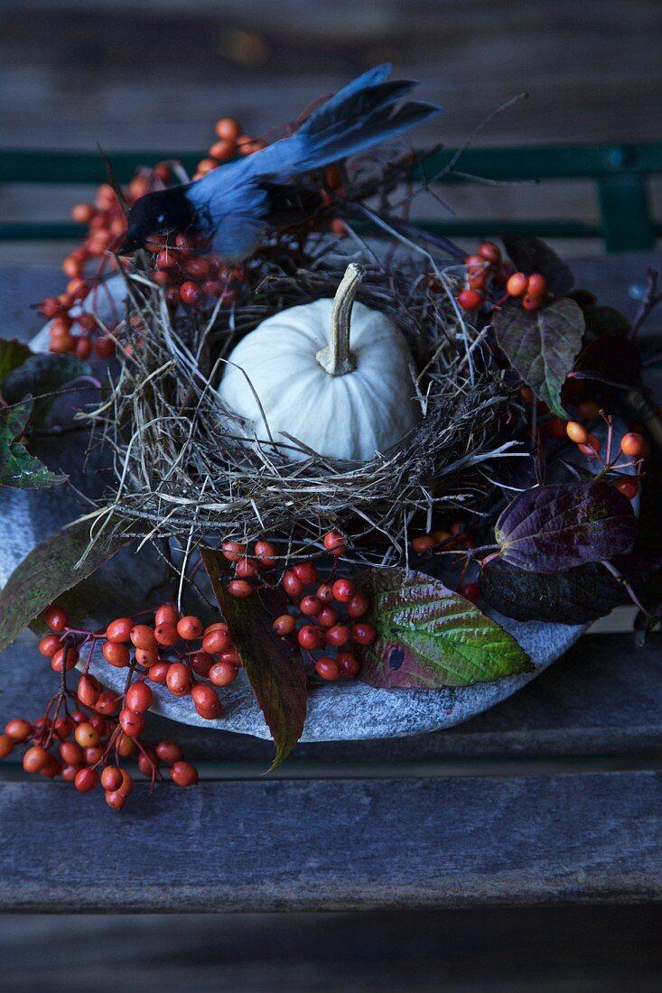 Autumn centrepiece with bird's nest and pumpkin