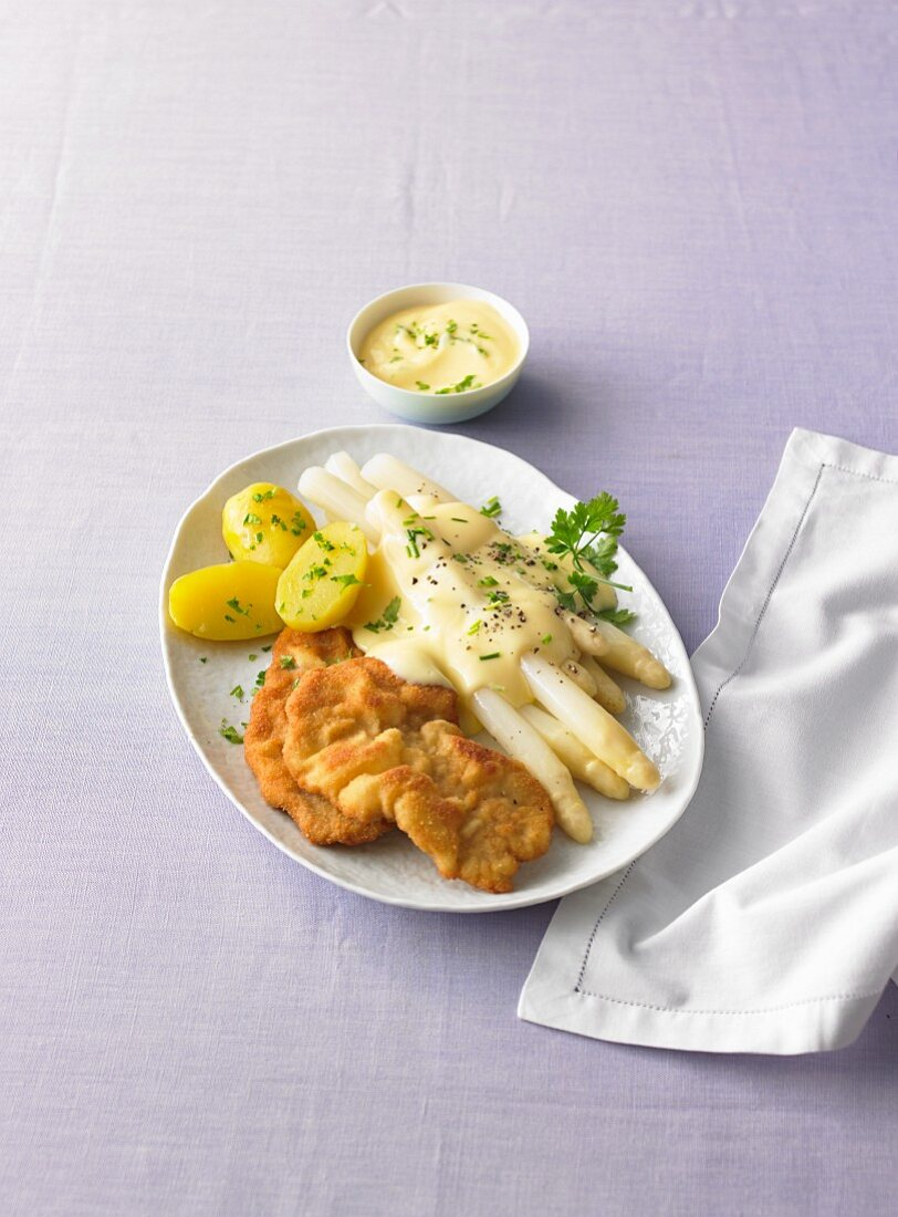 Chicken schnitzel with asparagus, hollandaise, and parsley potatoes