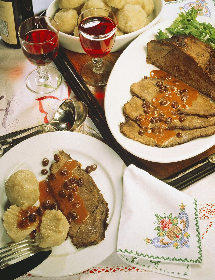 Sliced marinated beef with raisin sauce & dumplings