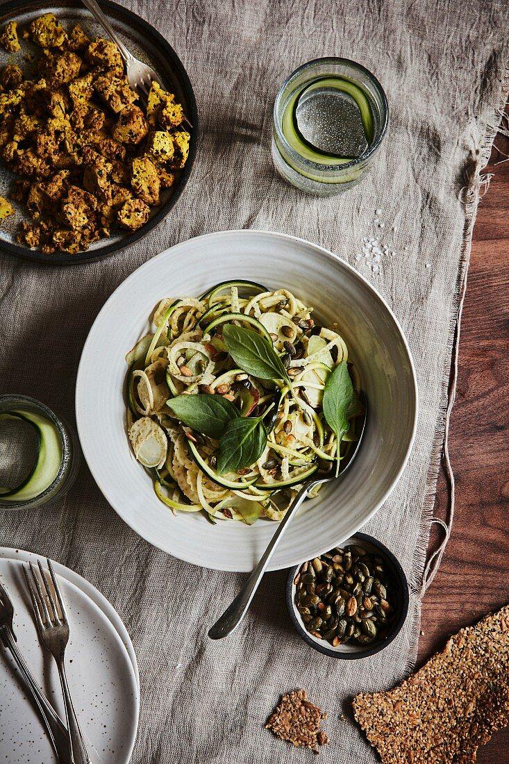 Zucchini pasta with turmeric and tofu