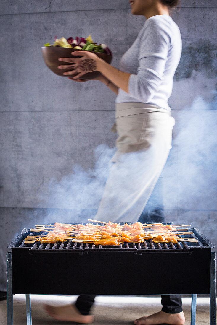 Satay skewers being grilled