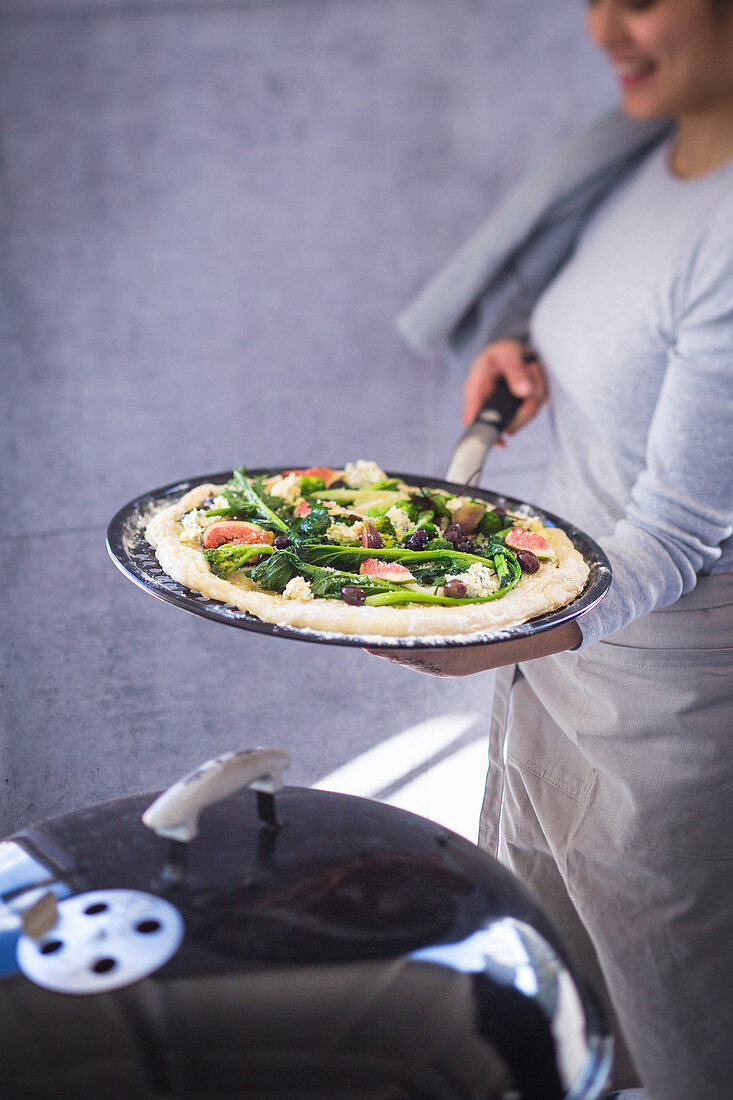 Pizza with rapini, figs, olives and blue cheese (unbaked)
