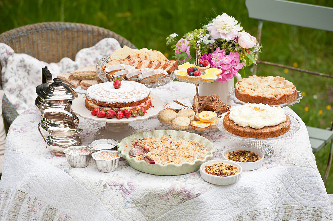 A garden table laid for afternoon tea