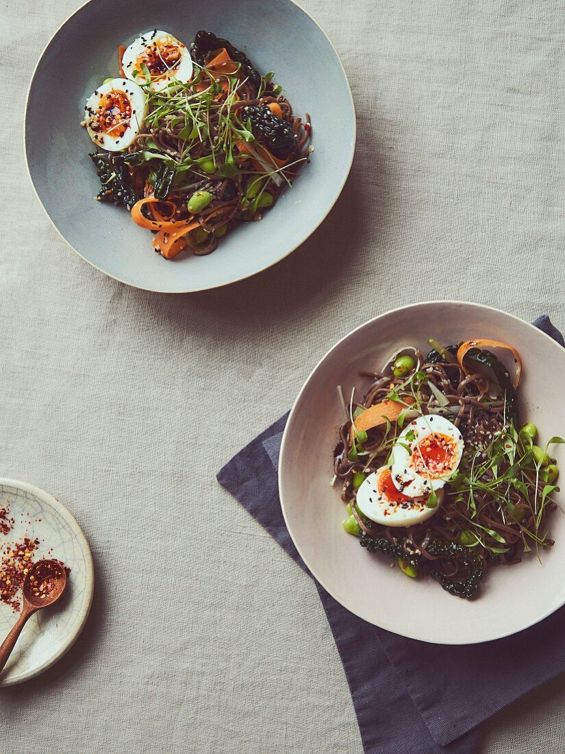 Soba noodles, pickled cavolo nero, carrot, and sesame, mixed seeds, spring onion shredded, coriander, sprouts (optional), frozen edaname, soft poached egg