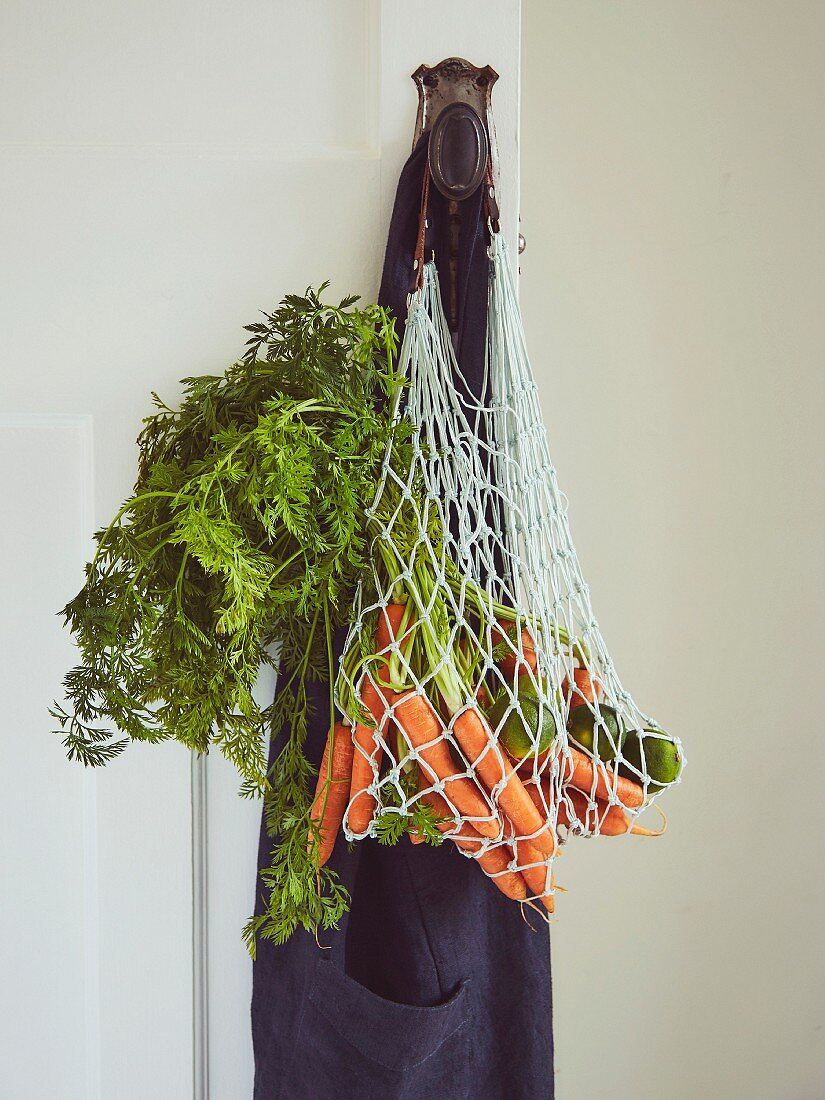 Carrots in shopping bag