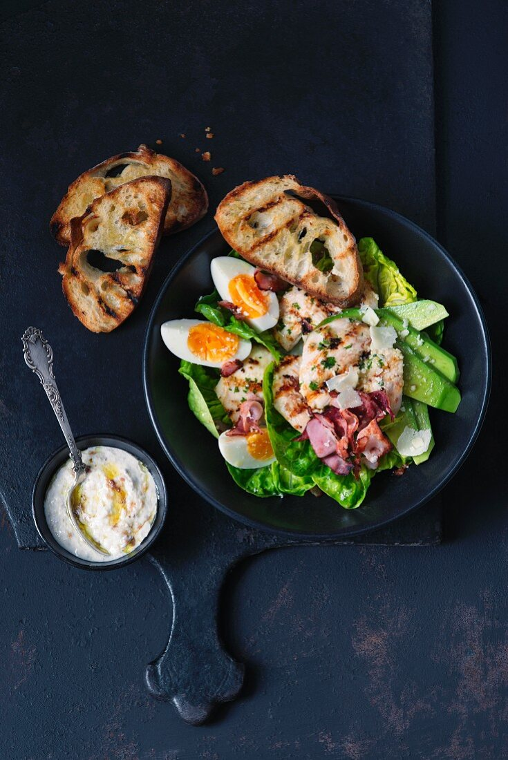 Chicken salad with boiled eggs and grilled bread