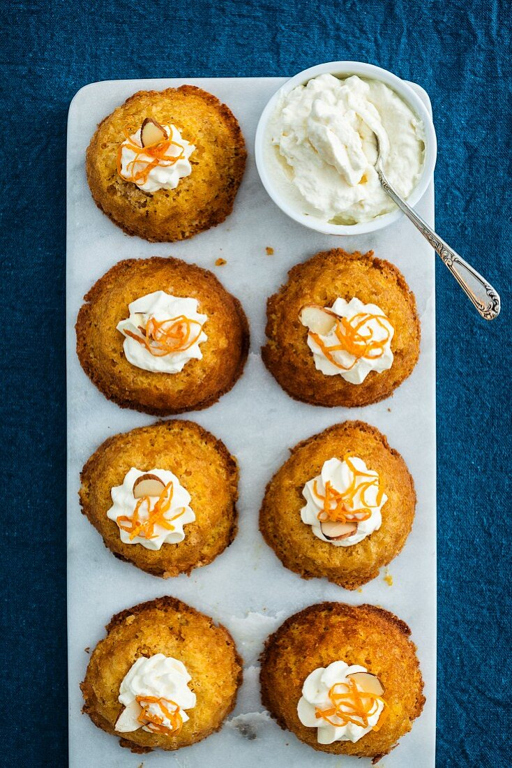 Orange and almond cupcakes with cream (top view)