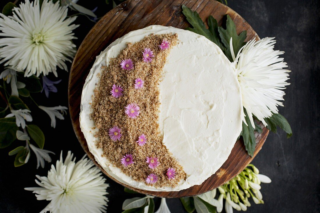 A marzipan almond cake with orange blossom mascarpone frosting, seen from above