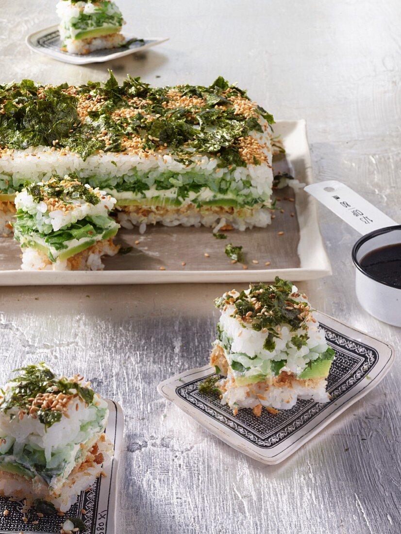 Sushi stacks with avocado, fresh cheese, wasabi and arugula