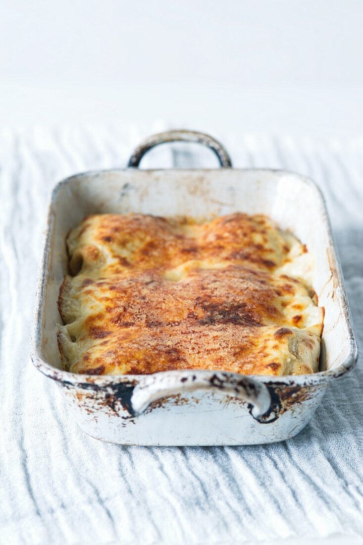 Oven-baked Austrian-style rolled pancakes in a casserole dish