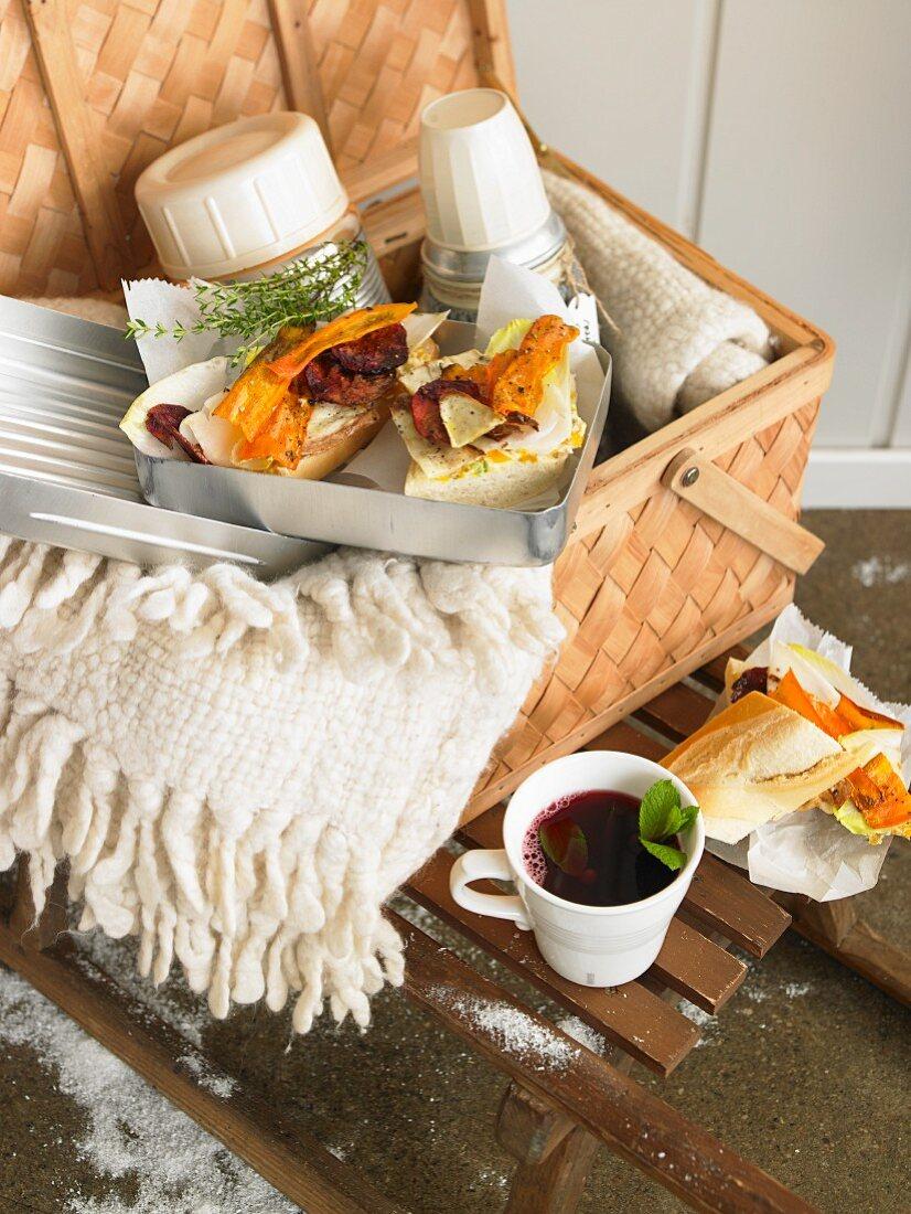 A winter sandwich in a picnic basket