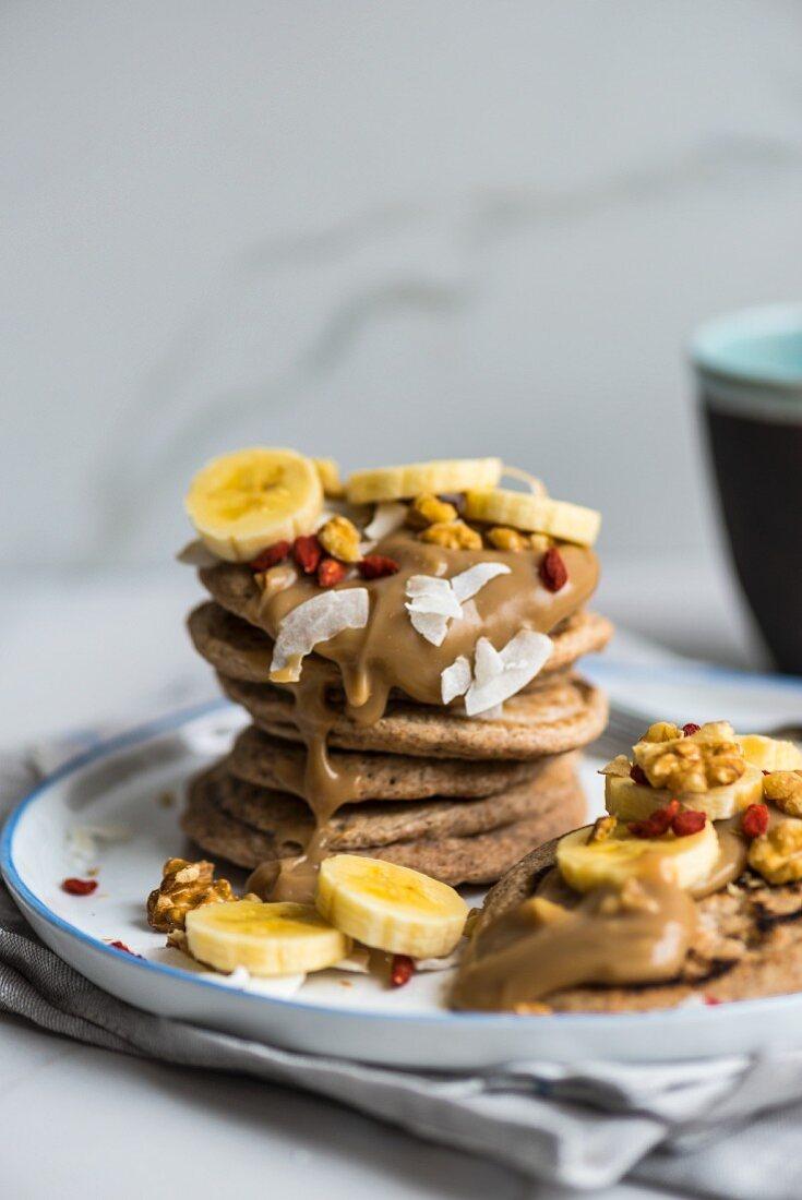 Vegan spelt pancakes with bananas, goji berries and coconut