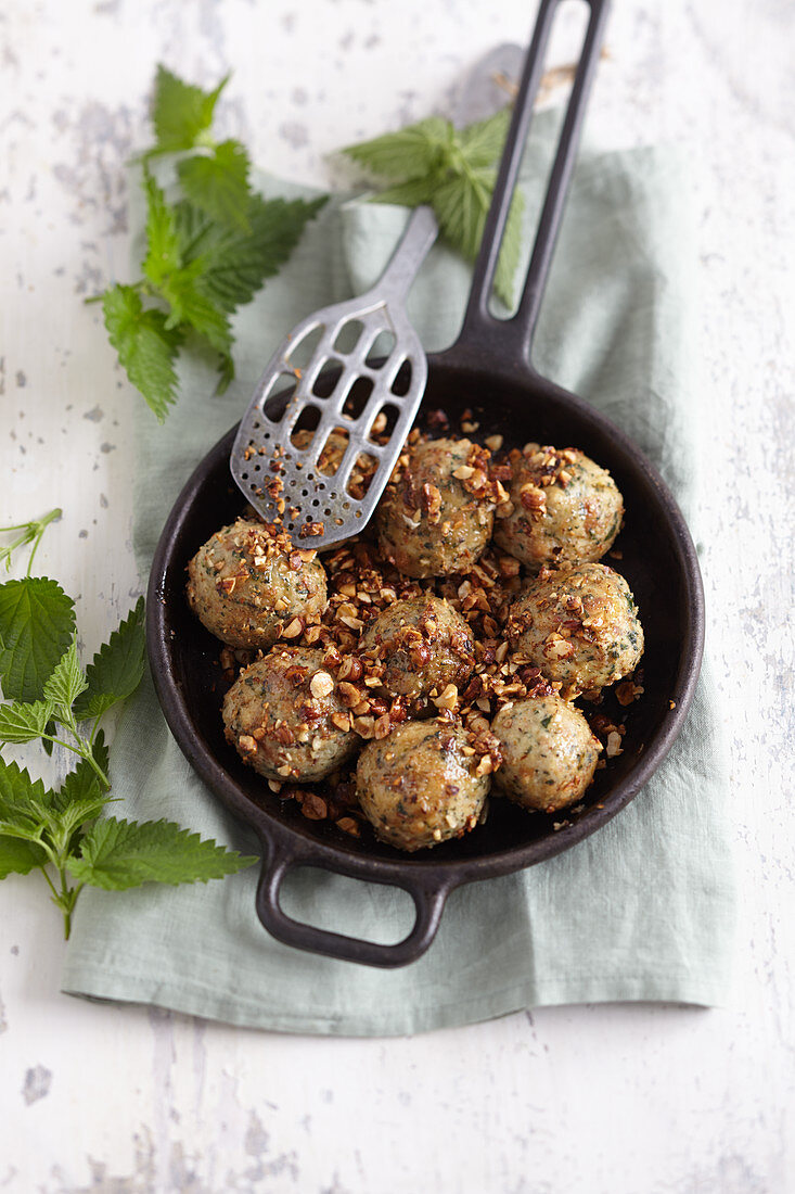 Stinging nettle bread dumplings with a butter and nut sauce